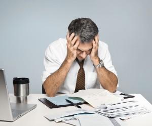 man concerned about business debt